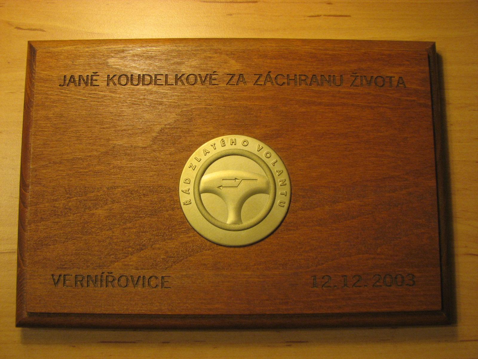 Pamětní medaile na podkladové desce